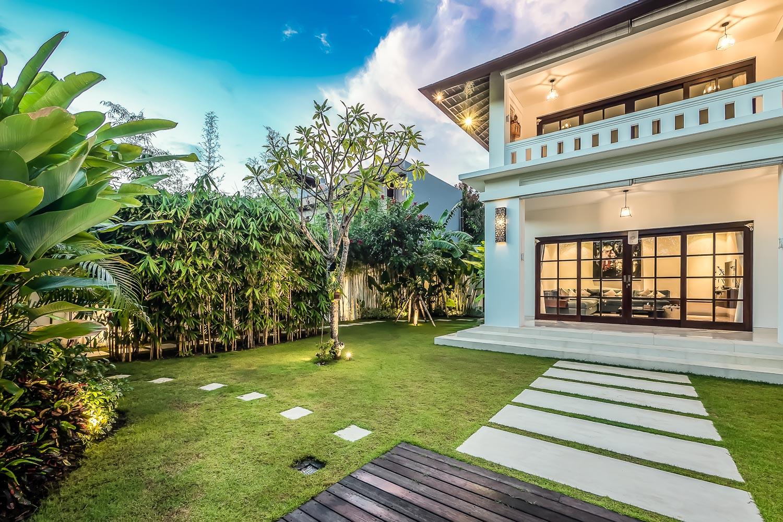 villa tjitrap bali - luxury villa garden entertainment room